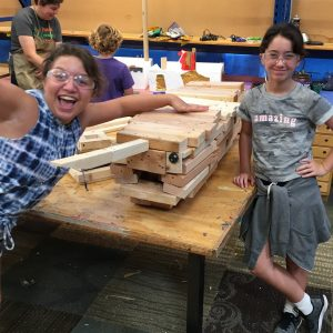 Two tinkerers and their wooden narwhal