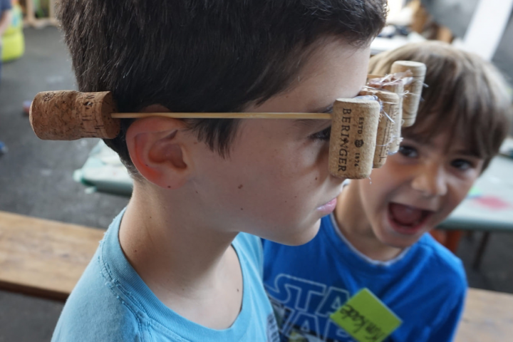 child with cork glasses
